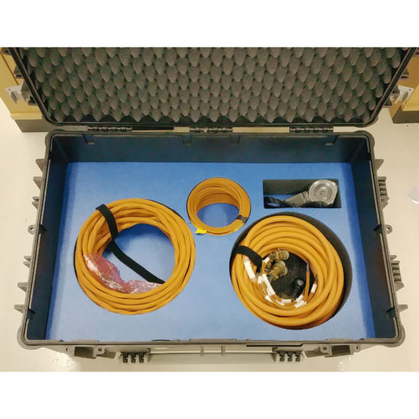 PCG custom transit case showing cables in lower compartments from above